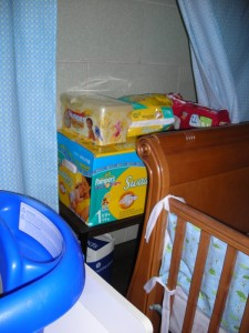 My secret diaper storage, cleverly hidden behind the crib.
